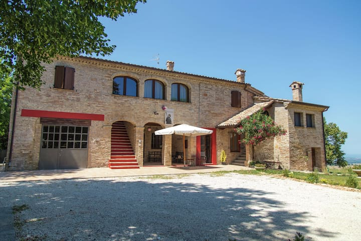 Mini apartment in building dating from 1600 in the rolling countryside with a sea view.