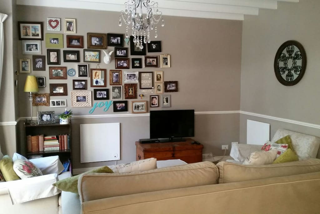 As you enter from the front door - the comfy lounge area. Flat screen HD TV and DSTV.