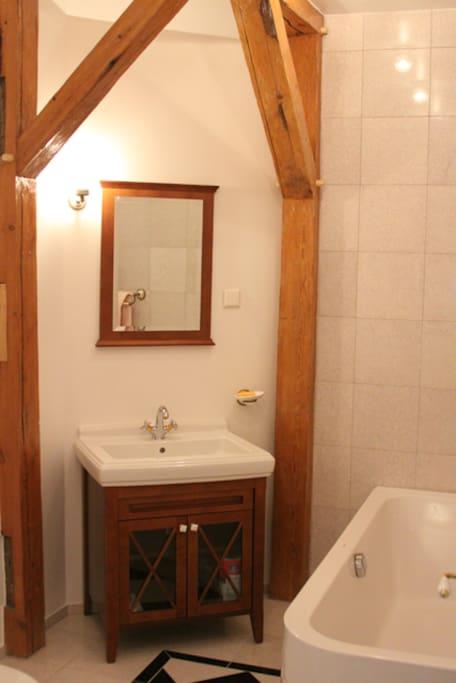Luxury bathroom, marble floor and full-size bath tub