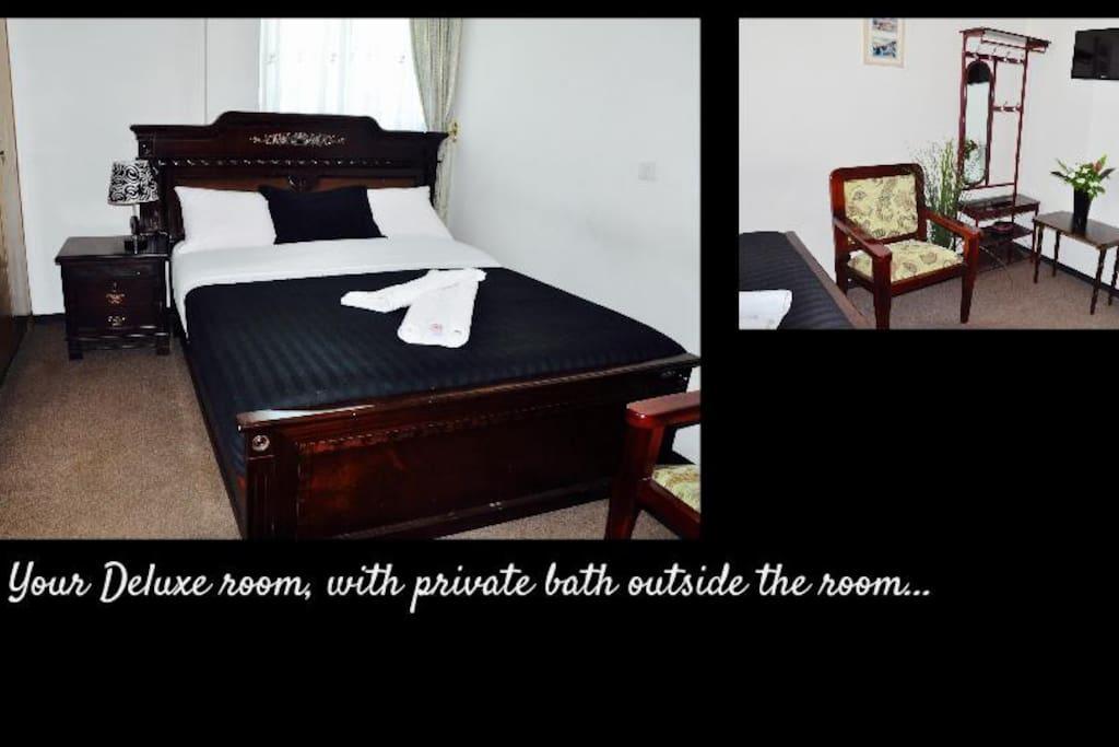 The deluxe room with en-suite bathroom