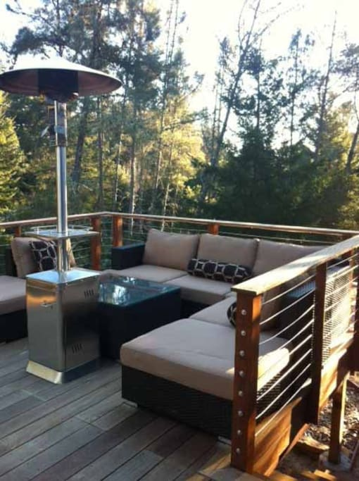 part of the deck near creek, fire pit, and hot tub