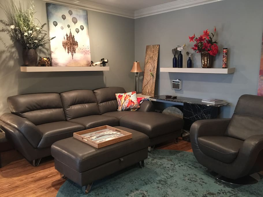 Comfortable Lounge area has leather seating.