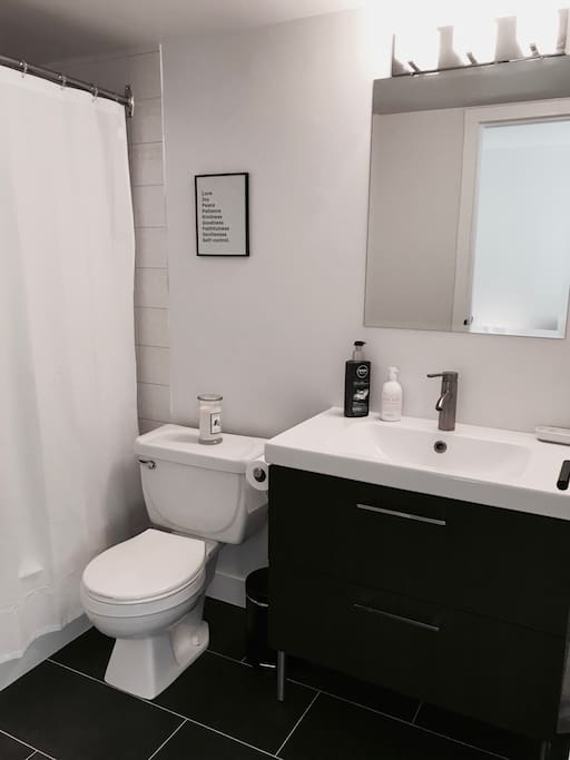 Private bathroom in bedroom with full bathtub.