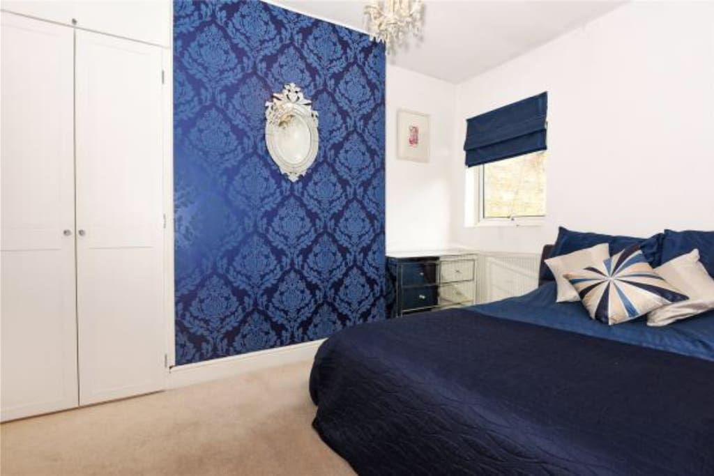 Double bed and wardrobe and drawer space.