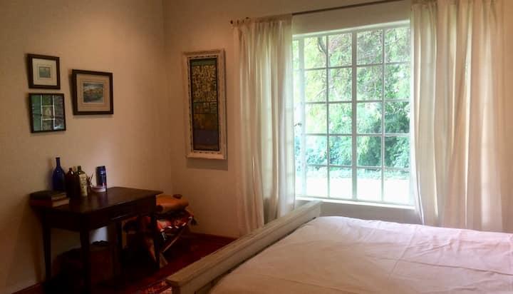 Spacious + artful en suite room + private garden