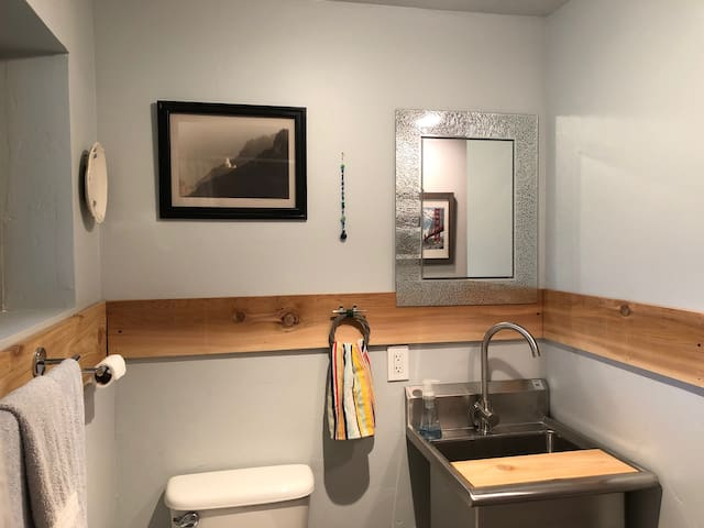 Newly remodeled bathroom with shower.
