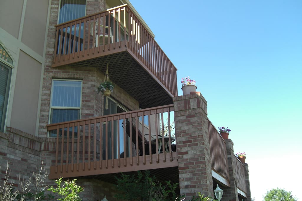 Rear of home with walk-out deck and mt./golf course views