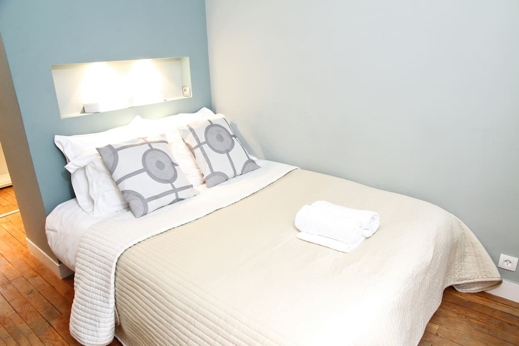 The bedroom features a walk in closet behind the bed. Clean linens are provided