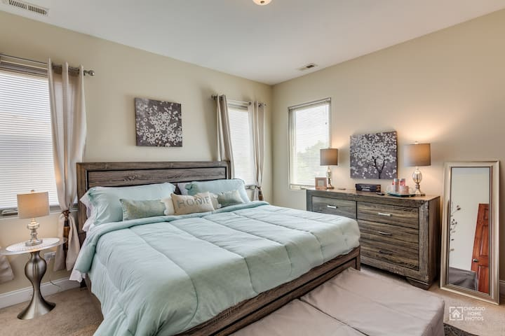 Master bedroom with king sized bed