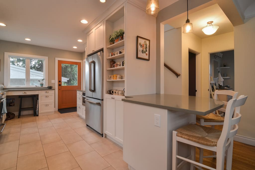 Newly renovated kitchen off the living room with access to backyard and deck