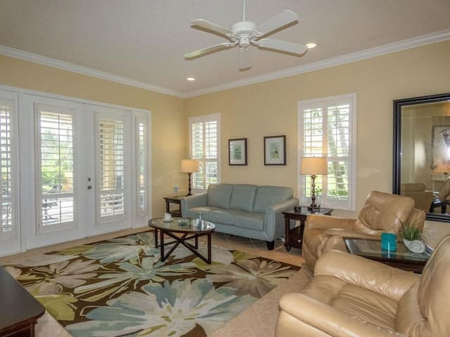 Lovely living room opens onto screened in porch