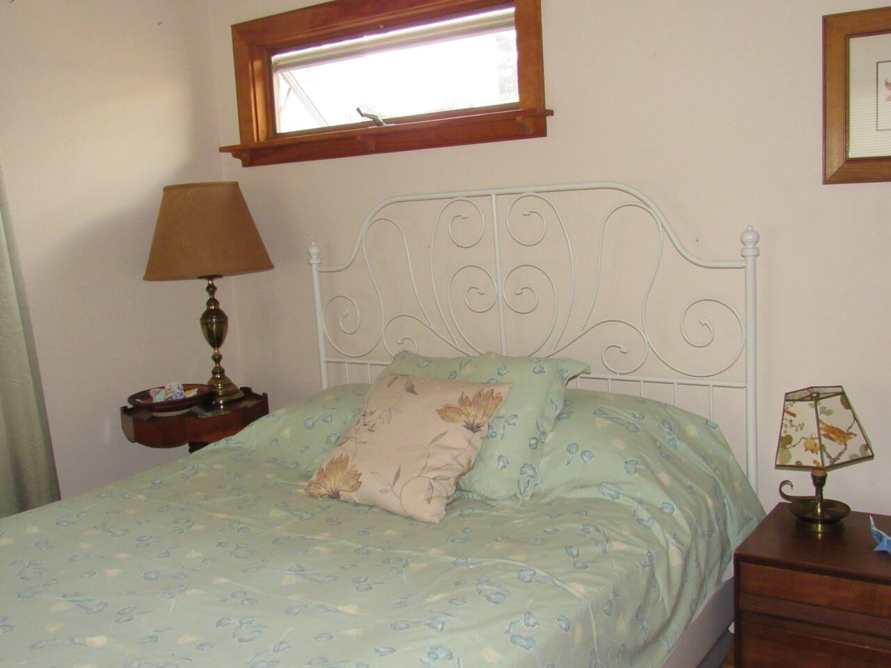 Queen bed, 2 bedside tables plus reading lamps.