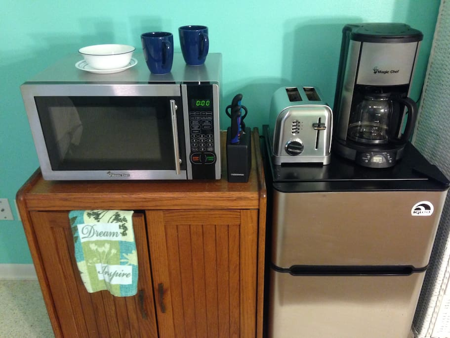 Microwave, Toaster, Electric Kettle, Coffee Maker, Coffee and tea, Hot Plate and Fridge.