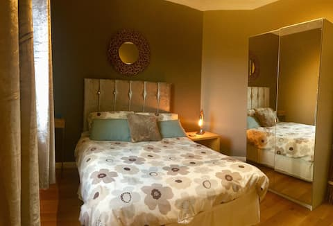 Double bed- breakfast - short bus trip to center