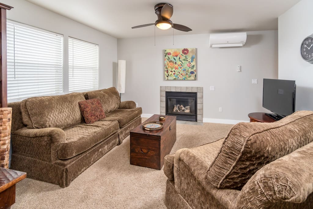 Welcoming living area with a cozy gas fireplace. Professional housekeeping services provided by Turnkey.