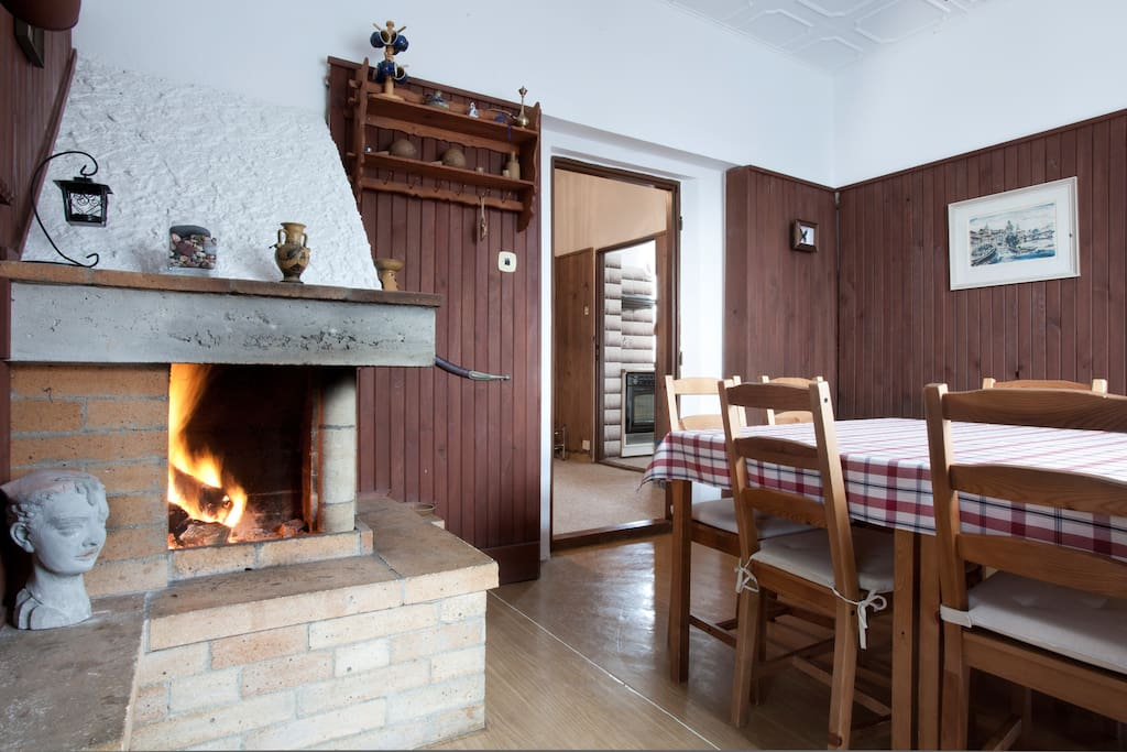 Dining room with 8 seats and fire place