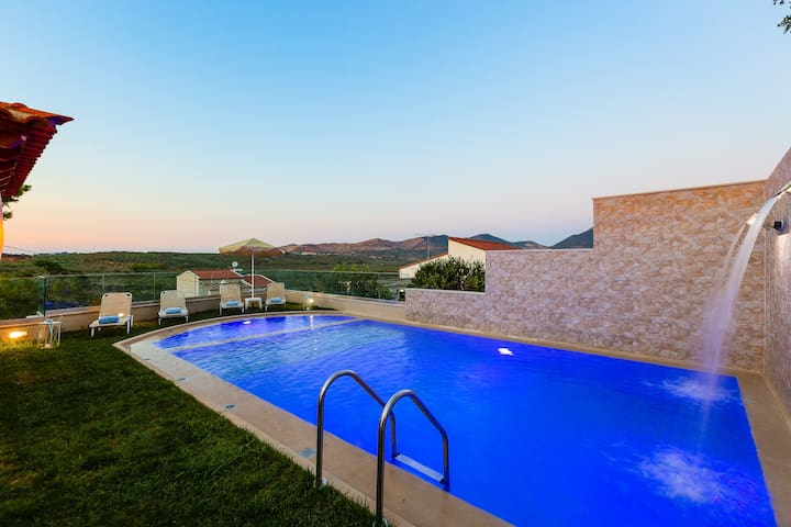 To start with, there is a sunbathing terrace, featuring a 50m2  private heated swimming pool!