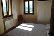Bedroom 2: light and airy, view towards mountains.