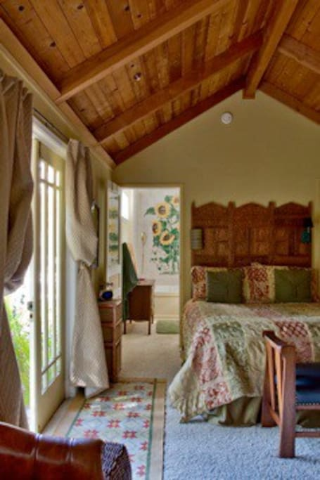 Luxurious queen bed within the cottage suite.