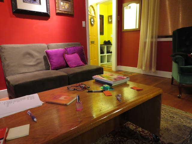 entry way is yellow, living room red. all art on the walls is mine. Guests may use the living room or dining room area.