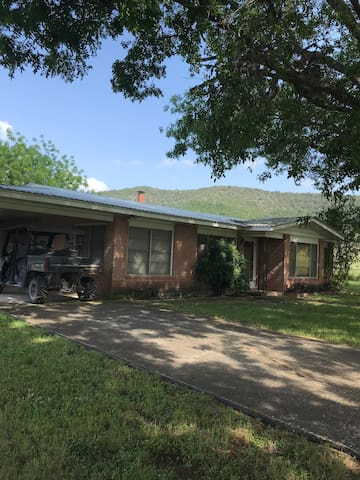 The Ranch House with attached carport & fenced yard.