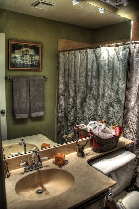 En suite bathroom for you! Newly redone shower and tile, too!