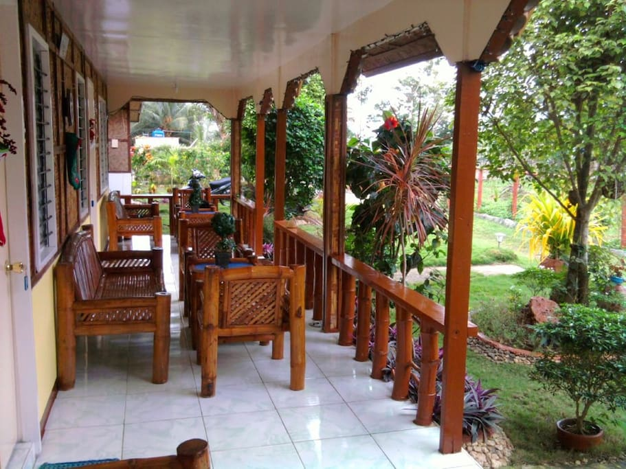 Relax outside the veranda and view the green scenery