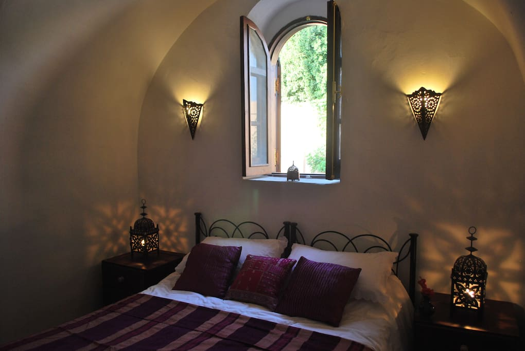 The bedroom looks out onto a small garden. When the shutters are open thee is lots of natural daylight.