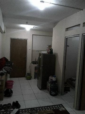 this is a door to go out from apartemen throught corridor and small pntry and toilet