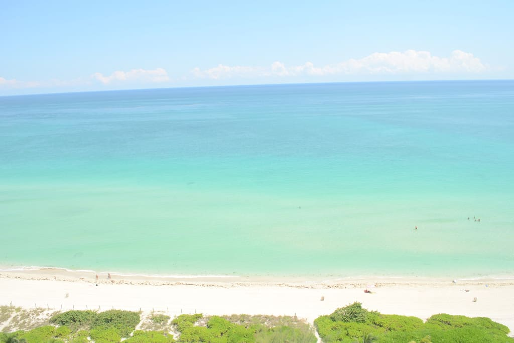 white sand beach view from window of apartment