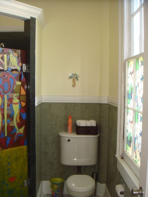 Glass shower stall was painted by noted local oil artist, Bassam Messaike.  The original toilet still works fine. The walls are Venetian plaster and floors are porcelain.