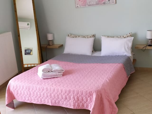 Bedroom with double bed and baby bed