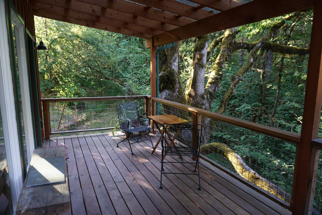 Enjoy your morning coffee on the back deck in the woods
