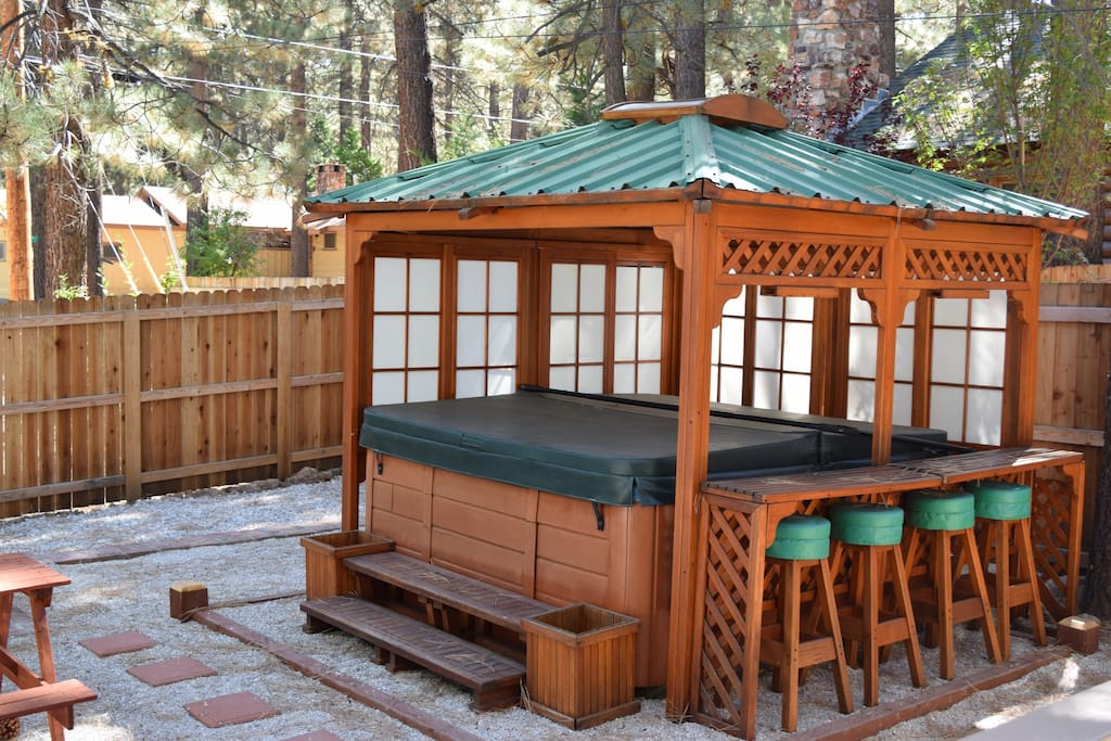 Beautiful Pergola with year round heated hot tub w/ bar top