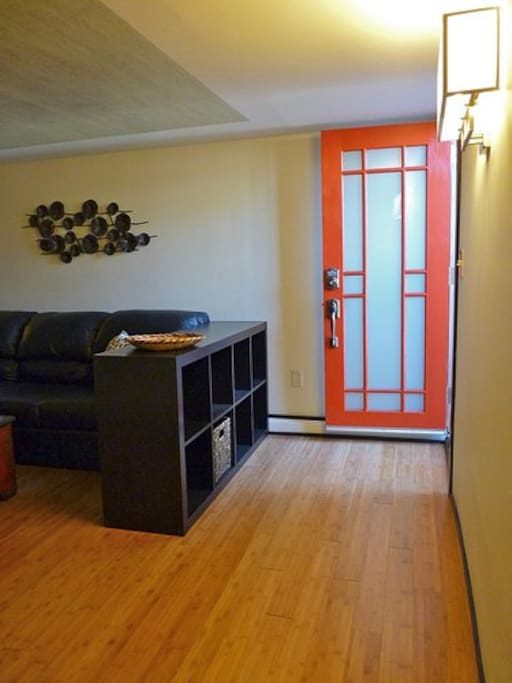 Frosted glass in front door provides both light and privacy to the apartment.