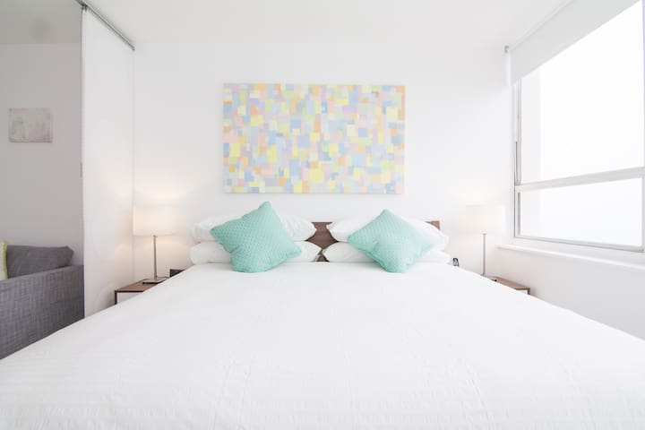 Maru's beautiful art work over the bed provides a cheerful splash of color that compliments the room and views even further  - Ryan (September 2017)
