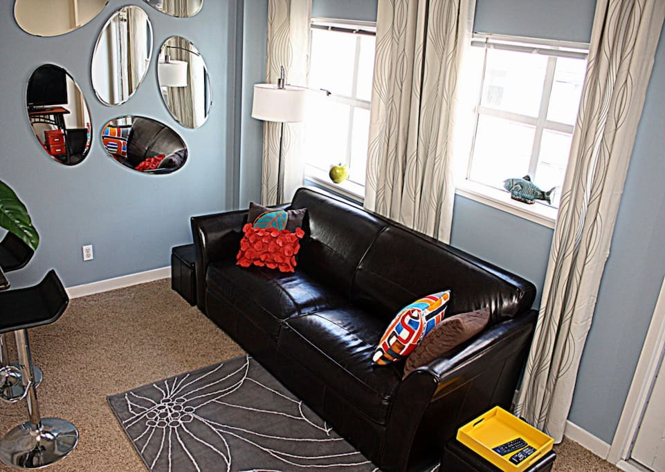 Living room with plush Queen sized leather hideaway sofabed.