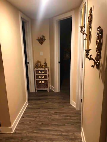 Main floor hallway leading into two bedrooms