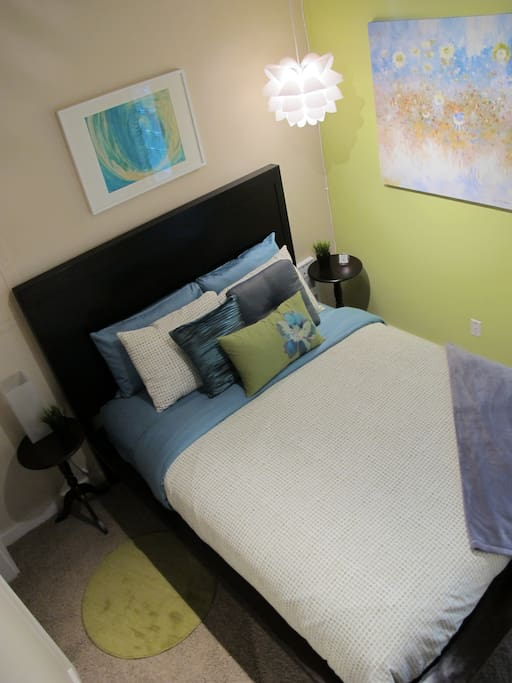 Pillow top Queen sized bed with premium bedding