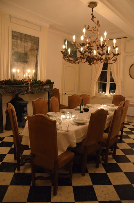 The white room is the dining room, with large table (seats 12), linnen, plenty tableware and candles ...