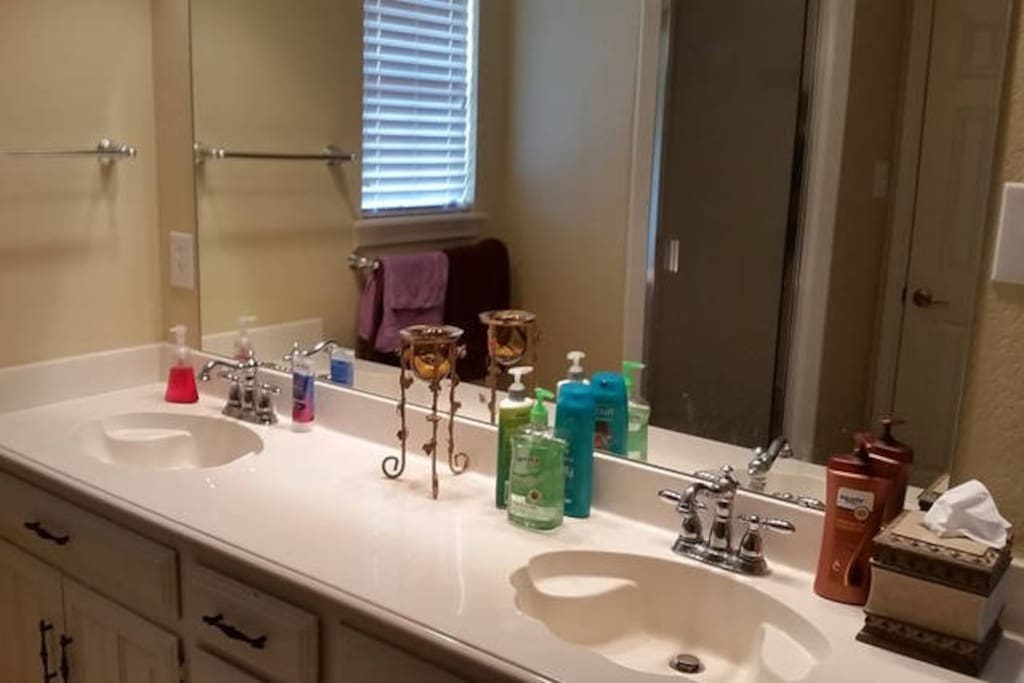 clean spacious bathroom with power walk in shower