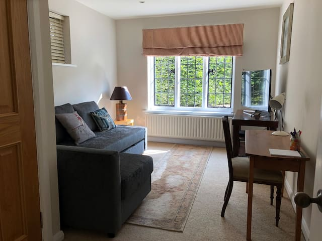 Sitting room with new sofa/bed, workspace, TV/DVD and BT high speed internet.