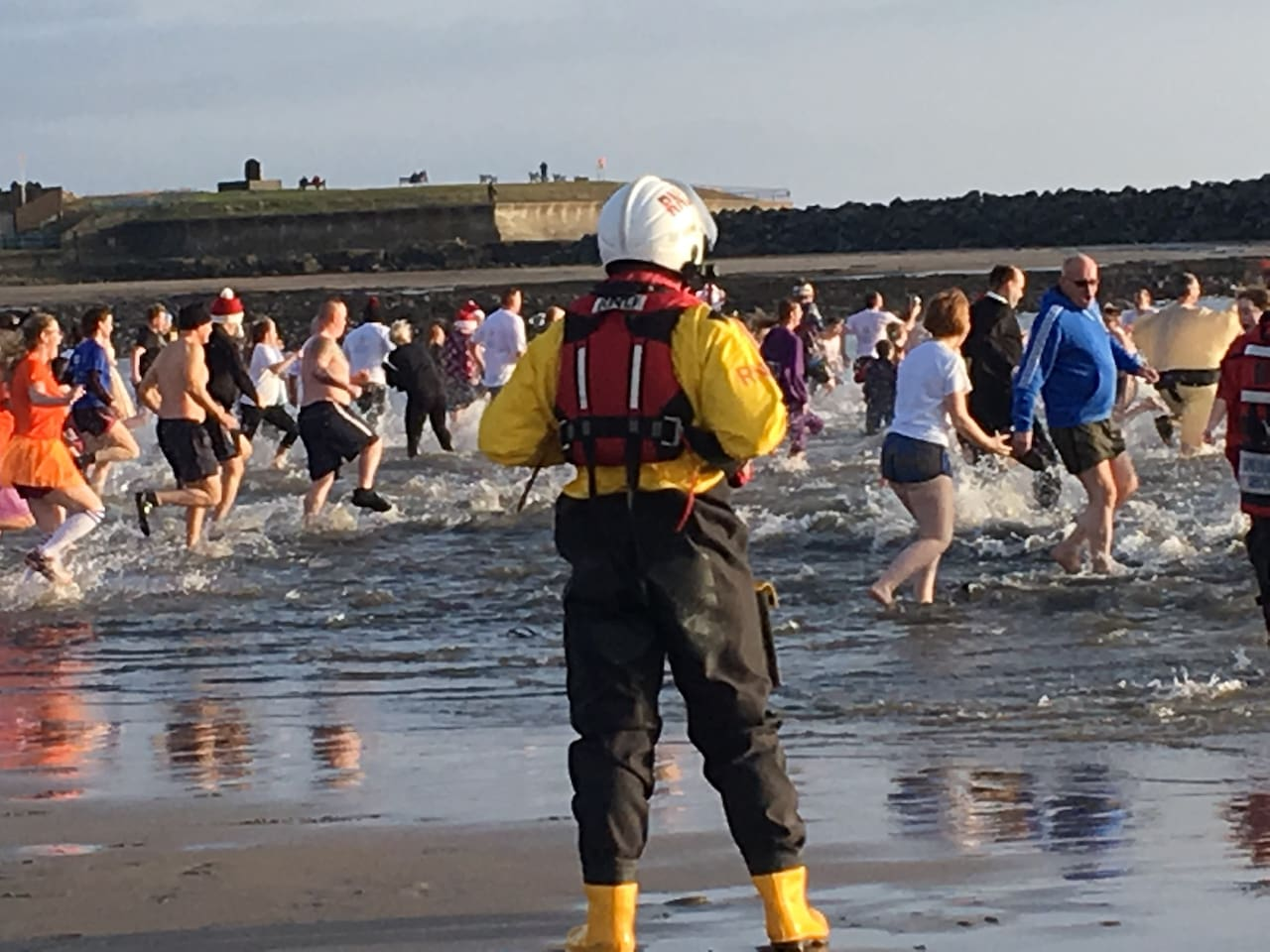 Discover life in this historic fishing village. As the community joins together for a Boxing Day dip in the sea. A popular community event which raises money for various local charities.  Thanks to the RLNI for helping to keep people safe in the sea.