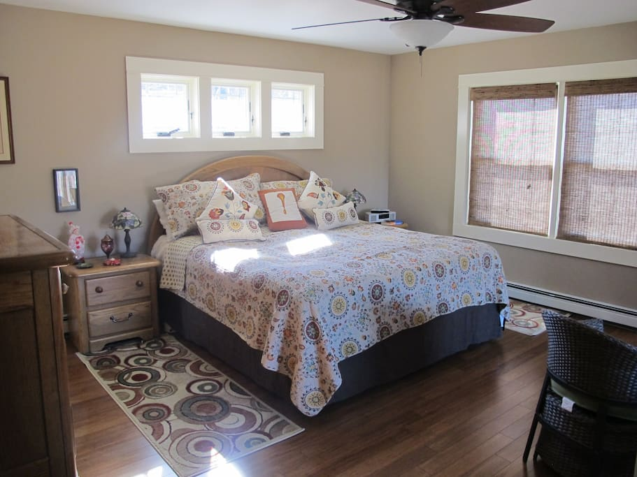 King size bed with ceiling fan above.