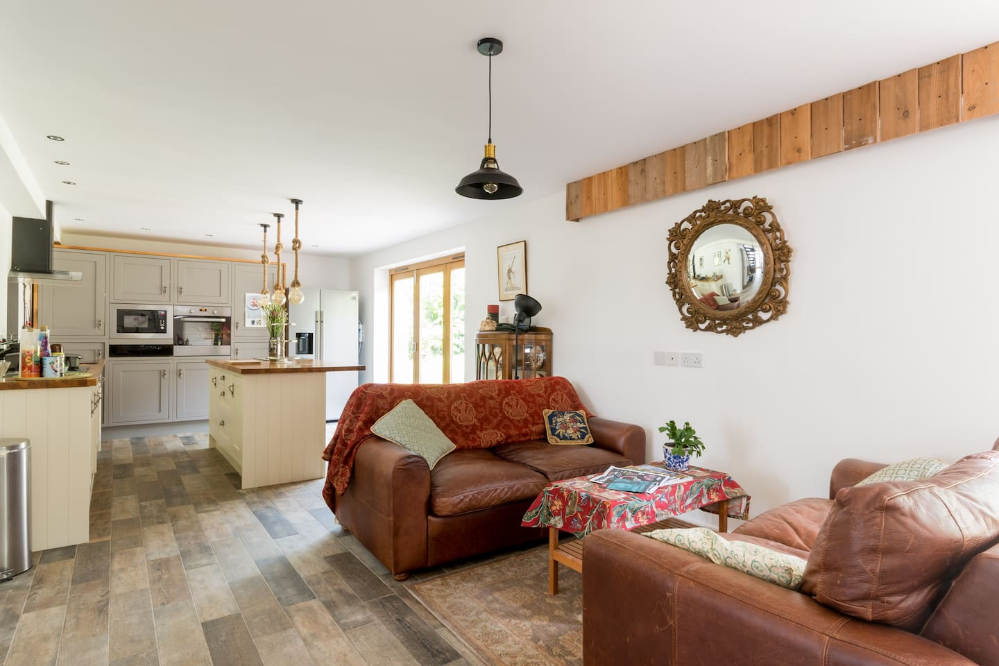 The open plan kitchen/ lounge area- for pre dinner drinks - cook in the kitchen whilst your party chills on the sofas