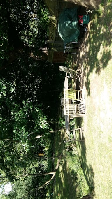 Large seating area at end of garden next to stream and woodland. Gas BBQ and firepit.