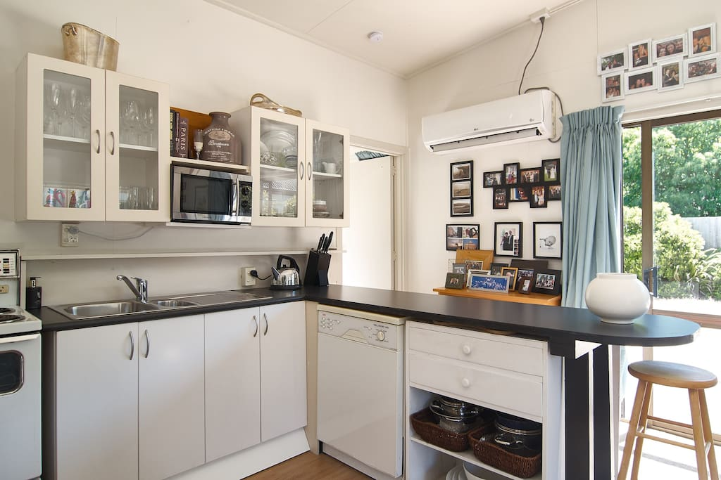 Kitchen, dishwasher and large heat pump to ensure you're comfortable!