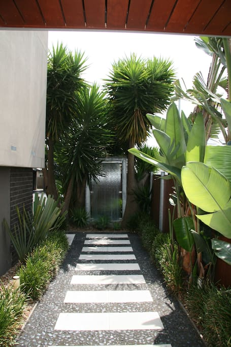 Lush greenery frames the entrance to the apartment
