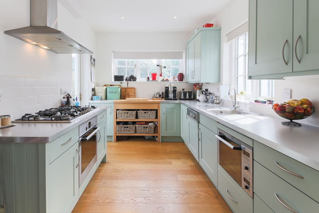 Bright bespoke kitchen for use of by guests