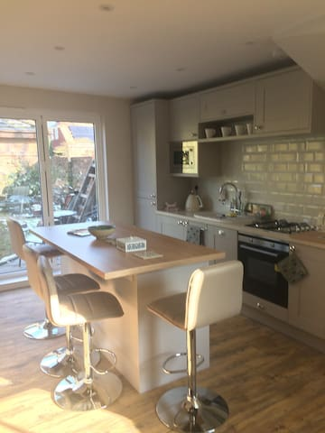 Lovely sunny breakfast kitchen looking out onto the garden and patio.